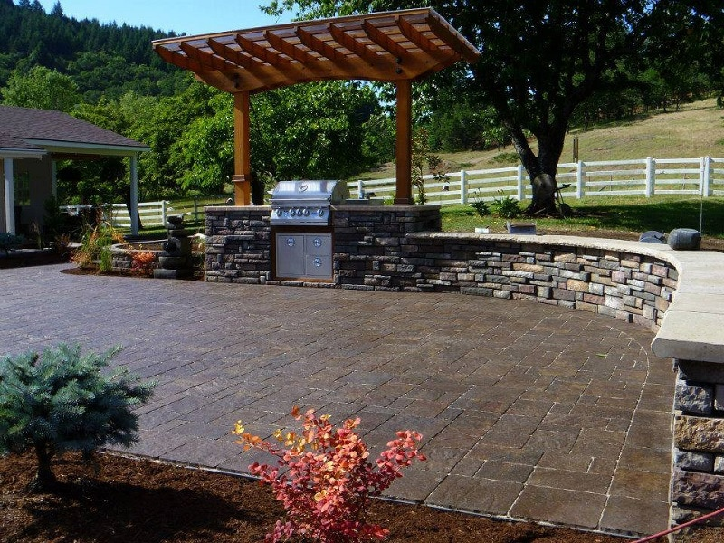 paver patio, outdoor kitchen, pergola, retaining wall